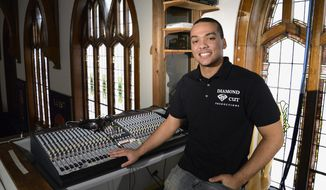 In this Jan. 16, 2014 photo, Breje Whitt, 17, poses for a photo in the sound booth at Family Life Church in Elgin, Ill. Whitt is an entrepreneur who launched his own DJ, sound and lighting company called Diamond Cut Productions. (AP Photo/Daily Herald, Laura Stoecker)  MANDATORY CREDIT, MAGS OUT