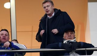 Manchester United manager David Moyes watches a Greek league match at Karaiskaki Stadium, in port of Piraeus, near Athens, on Wednesday, Feb. 5, 2014. The Scottish coach traveled to Greece to watch Olympiakos before his team faces the Greek side in the Champions League on Feb. 25 and March 19. The defending Greek champion ended its 23rd league game undefeated Wednesday, beating Panionios 2-0. (AP Photo/InTime Sports, Yorgos Matthaios)