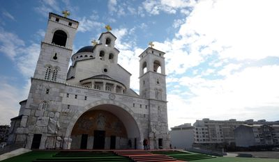 This photo taken Tuesday, Feb. 4, 2014 shows the Serbian Orthodox Church of Christ's Resurrection in Montenegro's capital Podgorica. The brightly-colored newly painted fresco in the Serbian Orthodox Church of Christ's Resurrection has triggered much attention and public controversy in this tiny former communist country. (AP Photo/Risto Bozovic)