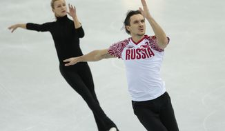 Russia's Tatiana Volosozhar and Maxim Trankov skate at the figure stating practice rink ahead of the 2014 Winter Olympics, Wednesday, Feb. 5, 2014, in Sochi, Russia. (AP Photo/Ivan Sekretarev)