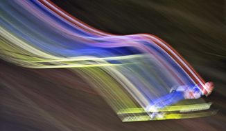 10ThingstoSeeSports - In this picture taken with a time exposure Richard Freitag, of Germany, soars through the air during the qualification at the FIS World Cup ski jumping in Willingen, Germany, Friday, Jan. 31, 2014. (AP Photo/Jens Meyer, File)