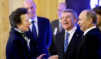 International Olympic Committee member Princess Anne of Great Britain, left, greets Russian President Vladimir Putin, right, IOC President Thomas Bach, second from right, and Sochi 2014 Olympics President Dmitry Chernyshenko, left, at an event welcoming IOC members ahead of the upcoming 2014 Winter Olympics at the Rus Hotel, Tuesday, Feb. 4, 2014, in Sochi, Russia. (AP Photo/David Goldman, Pool)