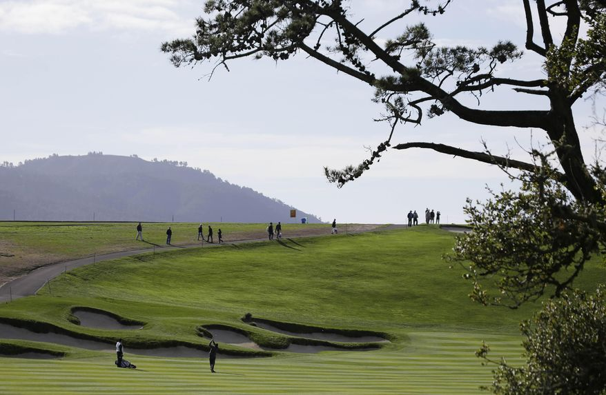 New England Patriots head coach Bill Belichick hits from the sixth fairway of the Pebble Beach Golf Links during a practice round for the AT&T Pebble Beach Pro-Am golf tournament Wednesday, Feb. 5, 2014, in Pebble Beach, Calif. (AP Photo/Eric Risberg)