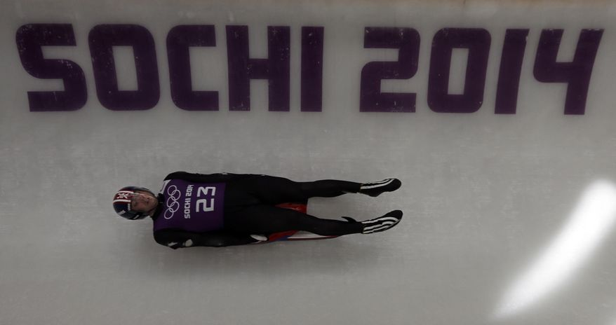 Chris Mazdzer of the United States completes a training run at the luge track for the men's singles luge at the 2014 Winter Olympics, Tuesday, Feb. 4, 2014, in Krasnaya Polyana, Russia. (AP Photo/Natacha Pisarenko)