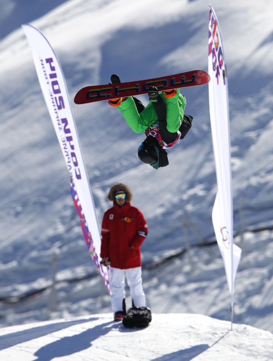 Ireland's Seamus O'Connor takes a jump during a snowboard slopestyle training session at the Rosa Khutor Extreme Park, prior to the 2014 Winter Olympics, Wednesday, Feb. 5, 2014, in Krasnaya Polyana, Russia.(AP Photo/Sergei Grits)