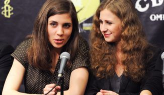 "Nadezhda ""Nadya"" Tolokonnikova, left, and Maria ""Masha"" Alekhina of Pussy Riot, participate in a press conference for Amnesty International's ""Bringing Human Rights Home"" concert at the Barclays Center on Wednesday, Feb. 5, 2014, in New York. (Photo by Evan Agostini/Invision/AP)"