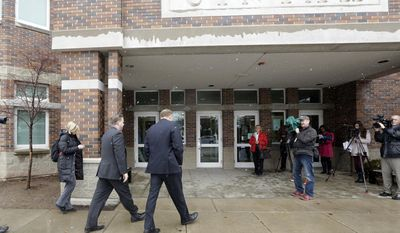 """Sen. Todd Weiler, R-Woods Cross, left, and Sen. Jim Dabakis, D-Salt Lake City, arrive at the Uintah Elementary School before stoping in for school lunch Thursday, Jan. 30, 2014, in Salt Lake City. A school district apologized Thursday to outraged parents after about 30 students at a Salt Lake City school had their lunches thrown out because of outstanding balances on their food accounts. Salt Lake City School District spokesman Jason Olsen said the district is investigating what happened at Uintah Elementary and working to make sure it doesn't happen again. """"This was a mistake. This was handled wrong,"""" Olsen said during a news conference outside the school. (AP Photo/Rick Bowmer)"""