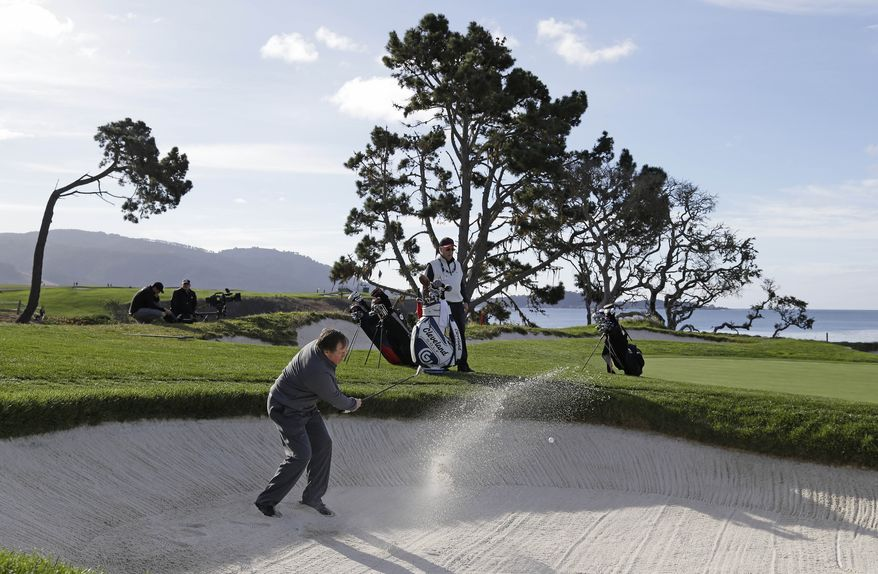New England Patriots head coach Bill Belichick fails to hit out of a bunker on the fourth hole of the Pebble Beach Golf Links during a practice round at the AT&T Pebble Beach Pro-Am golf tournament Wednesday, Feb. 5, 2014, in Pebble Beach, Calif. (AP Photo/Eric Risberg)