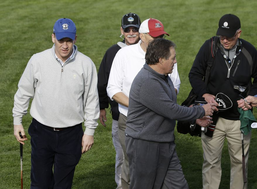 New England Patriots coach Bill Belichick, left, and Denver Broncos quarterback Peyton Manning, right, walk off the fifth green of the Pebble Beach Golf Links during a practice round of the AT&T Pebble Beach Pro-Am golf tournament Wednesday, Feb. 5, 2014, in Pebble Beach, Calif. (AP Photo/Eric Risberg)