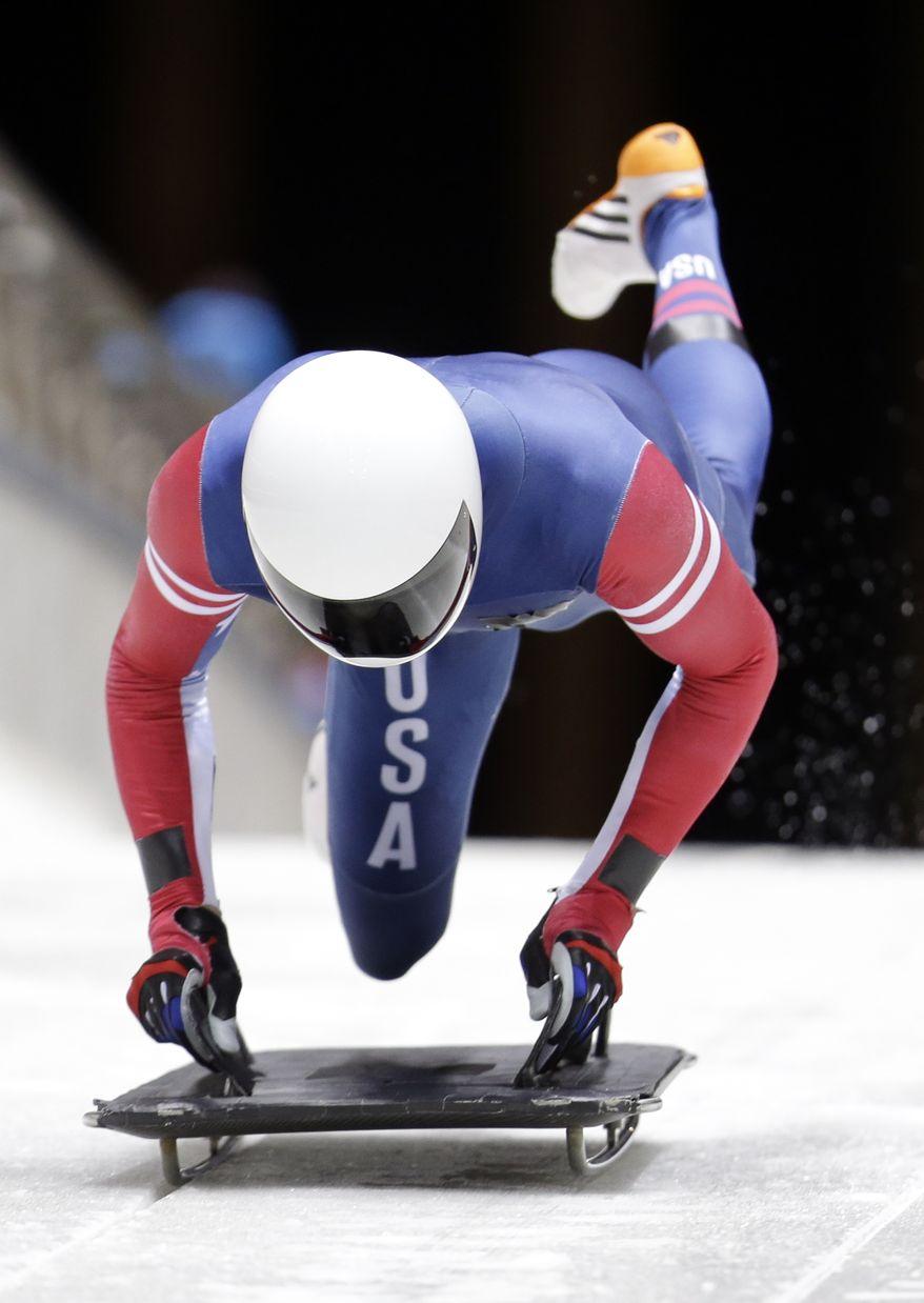 Matthew Antoine of the United States starts his training run prior to the 2014 Winter Olympics, Wednesday, Feb. 5, 2014, in Krasnaya Polyana, Russia. (AP Photo/Natacha Pisarenko)