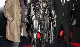 Actors Gary Oldman and Joel Kinnaman pose with RoboCop at the World Premiere of RoboCop, held at the BFI Southbank, London, on Wednesday, Feb. 5, 2014. (Photo by Jon Furniss/Invision/AP)