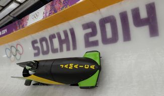 The JAM-1 sled from Jamaica, takes a turn during a training run for the men's two-man bobsled at the 2014 Winter Olympics, Thursday, Feb. 6, 2014, in Krasnaya Polyana, Russia. (AP Photo/Michael Sohn)