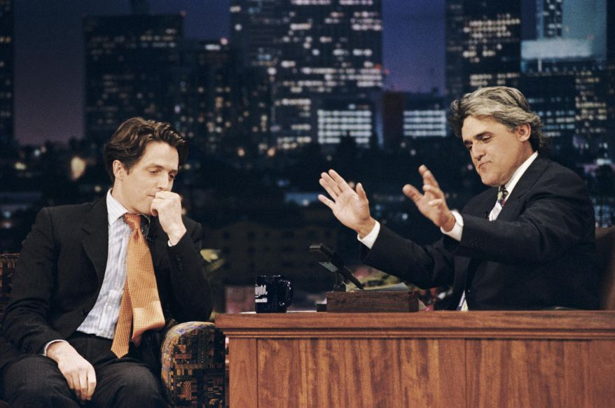 "This July 10, 1995 photo released by NBC shows actor Hugh Grant, left, during an interview with host Jay Leno on ""The Tonight Show with Jay Leno,"" in Burbank, Calif., two weeks after Grant's highly publicized arrest for picking up a prostitute. After 22 years, Leno will host his last show on Thursday, Feb. 6, 2014. (AP Photo/NBC, Margaret Norton)"