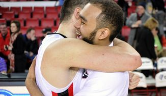 Georgia forward Cameron Forte (11) gets a hug from Georgia forward Nemanja Djurisic (42) after the second half of an NCAA college basketball game on Thursday, Feb. 6, 2014 in Athens, Ga. Georgia won 91-78. (AP Photo/Athens Banner-Herald, AJ Reynolds) MAGS OUT; MANDATORY CREDIT