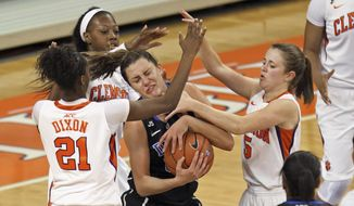 Duke's Haley Peters, center, is trapped between Clemson's Nikki Dixon (21), Kelly Gramlich, right, and Quinyotta Pettaway during the second half of an NCAA college basketball game Thursday, Feb. 6, 2014, in Clemson, S.C. (AP Photo/Anderson Independent-Mail, Mark Crammer) SENECA OUT  GREENVILLE OUT