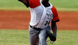 Cuba pitcher Vicyhandri Odelin throws a ball in the first inning of a Caribbean Series baseball game against Puerto Rico in Porlamar, Venezuela, Tuesday, Feb. 4, 2014. (AP Photo/Fernando Llano)