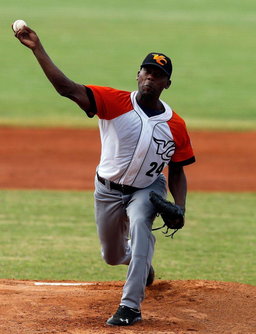 Cuba pitcher Vicyhandri Odelin throws a ball in the first inning of a Caribbean Series baseball game against Puerto Rico in Porlamar, Venezuela, Tuesday, Feb. 4, 2014. (AP Photo/Fernando Llano)
