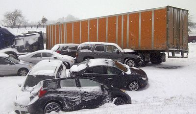 This image provided by the Oregon Department of Transportation shows a multi-car pileup Thursday Feb. 6, 2014 near Albany, Ore. As many of 25 vehicles collided in clusters in southbound lanes near Albany, the state Department of Transportation said. A detour was then blocked by another crash.  This storm is expected to drop snow throughout the state, with as many as nine inches accumulating in the central Willamette Valley.(AP Photo/ Oregon Department of Transportation)