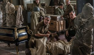 "From left: Dimitri Leonidas, George Clooney, John Goodman, Bob Balaban and Matt Damon star in ""The Monuments Men,"" a movie that fails both art and people equally. (ASSOCIATED PRESS)"