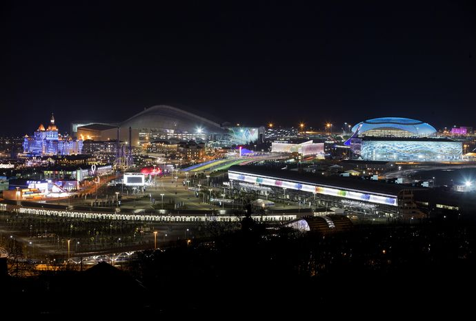 The Olympic Park is illuminated early Thursday morning, Feb. 6, 2014, in Sochi, Russia, prior to the start of the 2014 Winter Olympics. (AP Photo/Pavel Golovkin)