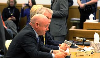 Mark Kelly, husband of former U.S. Rep. Gabrielle Giffords, D-Ariz., speaks to the Oregon Senate Judiciary Committee on Thursday, Feb. 6, 2014, in Salem, Ore. Kelly is backing a bill that would require background checks for private gun sales. (AP Photo/Chad Garland)