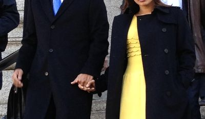 Mathew Martoma, left, leaves federal court in New York City with his wife, Rosemary, Thursday, Feb. 6, 2014, after being convicted of helping his company earn more than a quarter billion dollars illegally through trades based on secrets about the testing of a potential breakthrough Alzheimer's drug. The verdict capped a three-week trial that featured testimony from two prominent doctors who confessed spilling secrets to Mathew Martoma during lucrative consultations with financiers. (AP Photo/Larry Neumeister)