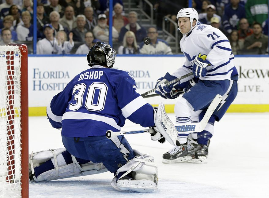 Toronto Maple Leafs right wing David Clarkson (71) looks for a rebound after Tampa Bay Lightning goalie Ben Bishop (30) made a save during the first period of an NHL hockey game, Thursday, Feb. 6, 2014, in Tampa, Fla. (AP Photo/Chris O'Meara)