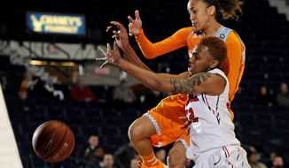 Tennessee guard Meighan Simmons and Mississippi forward Tia Faleru (32) vie for a rebound during the first half of an NCAA college basketball game in Oxford, Miss., Thursday, Feb. 6, 2014. (AP Photo/Thomas Graning)