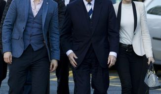 Coronation Street actor William Roache, center right, arrives with supporters at Preston Crown Court to continue his trial for sexual offences against five girls, in Preston, England, Thursday, Feb. 6, 2014. With Roache are his sons James, left,  Linus, rear center left, and daughter Verity, right. Roache who has appeared in Coronation Street since its first episode on 9 December 1960 denies two counts of raping a 15-year-old girl in east Lancashire in 1967, and four indecent assaults involving four girls aged between 11 or 12 and 16 in the Manchester area in 1965 and 1968. (AP Photo/Jon Super)