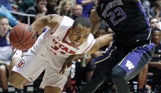 Utah's Brandon Taylor (11) drives to the basket as Washington's C.J. Wilcox (23) defends in the first half of an NCAA college basketball game Thursday, Feb. 6, 2014, in Salt Lake City. (AP Photo/Rick Bowmer)