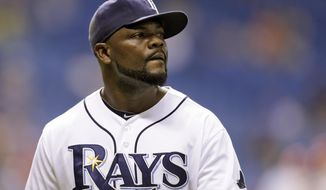 FILE - This Aug. 27, 2013 file photo shows Tampa Bay Rays relief pitcher Fernando Rodney during the ninth inning of a baseball game in St. Petersburg, Fla. The offseason spending by the Seattle Mariners has continued after reaching agreement on a $14 million, two-year deal with Fernando Rodney, according to a person familiar with the deal. The person spoke to The Associated Press on Thursday, Feb. 6, 2014 on the condition of anonymity because the deal was still pending a physical. (AP Photo/Chris O'Meara, file)
