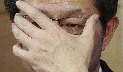 South Korean Unification Minister Ryoo Kihl-jae adjusts his glasses during a press conference at the government complex in Seoul, South Korea, Thursday, Feb. 6, 2014. While North Korea is threatening to cancel a reunion of Korean War-divided families later this month only one day after agreeing on dates for the emotional meetings, Ryoo said that the agreement must be followed. (AP Photo/Ahn Young-joon)
