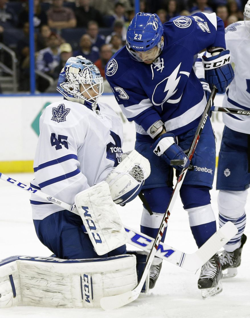 Toronto Maple Leafs goalie Jonathan Bernier (45) makes a save on a shot by Tampa Bay Lightning right wing J.T. Brown (23) during the second period of an NHL hockey game, Thursday, Feb. 6, 2014, in Tampa, Fla. (AP Photo/Chris O'Meara)
