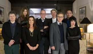 Members of the jury from top left, actress Greta Gerwig, jury president James Schamus, actress Trinie Dyrholm, actor Tony Leung, from bottom left director Michel Gondry, producer Barbara Broccoli, actor Christoph Waltz and director Mitra Farahani pose for photographers at a hotel in Berlin prior to the beginning of the International Film Festival Berlinale, Wednesday, Feb. 5, 2014. The festival will run from Feb. 6 until Feb. 16, 2014. (AP Photo/Axel Schmidt)