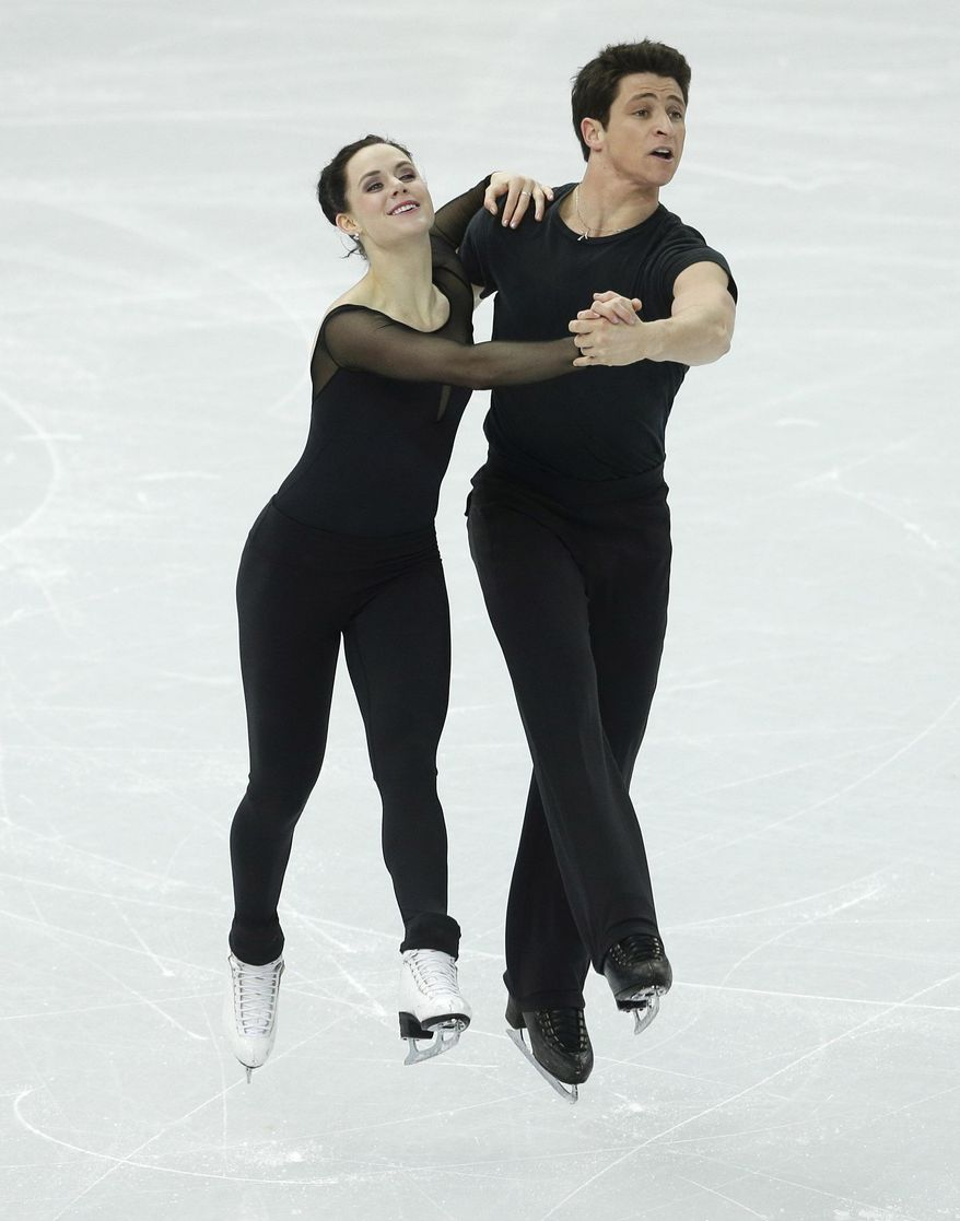 Scott and Tessa Moir of Canada practice during a the Ice Dance training session at the Iceberg Skating Palace ahead of the 2014 Winter Olympics, Wednesday, Feb. 5, 2014, in Sochi, Russia. (AP Photo/Darron Cummings)