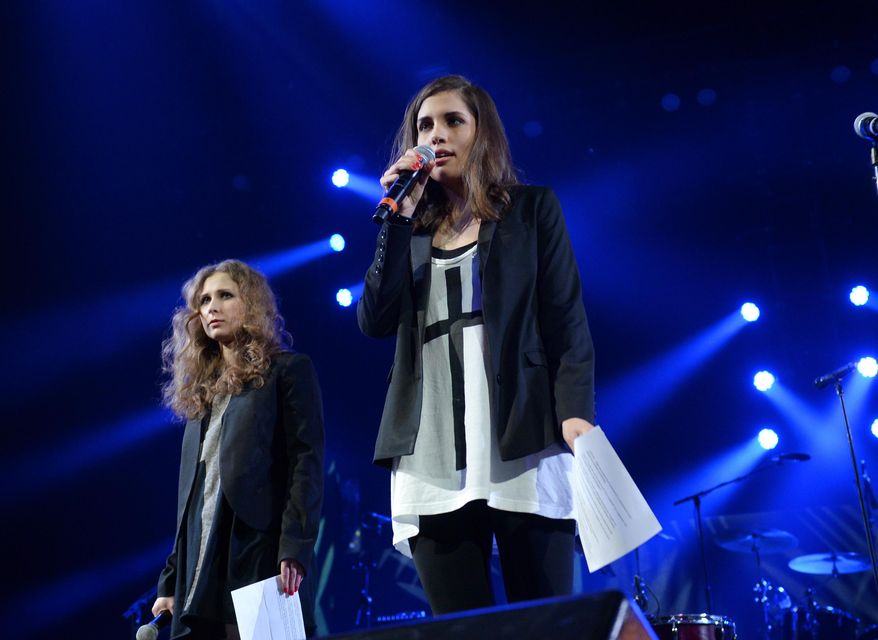 "Members of Pussy Riot, Maria Alekhina, left, and Nadya Tolokonnikova speak at Amnesty International's ""Bringing Human Rights Home"" Concert at the Barclays Center on Wednesday, Feb. 5, 2014 in New York. (Photo by Evan Agostini/Invision/AP)"