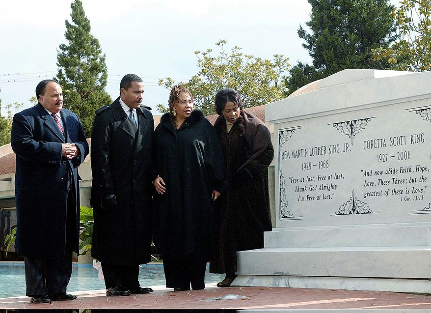 FILE-- In this file photo taken Nov. 20, 2006 the children of the Rev. Martin Luther King Jr. and Coretta Scott King from left, Martin Luther King III, Dexter King, the late Yolanda King and Bernice King stand next to a new crypt dedicated to their parents in Atlanta. Bernice is in a legal battle with her brothers over their father's Bible and Nobel Peace Prize medal. (AP Photo/W.A. Harewood, File)