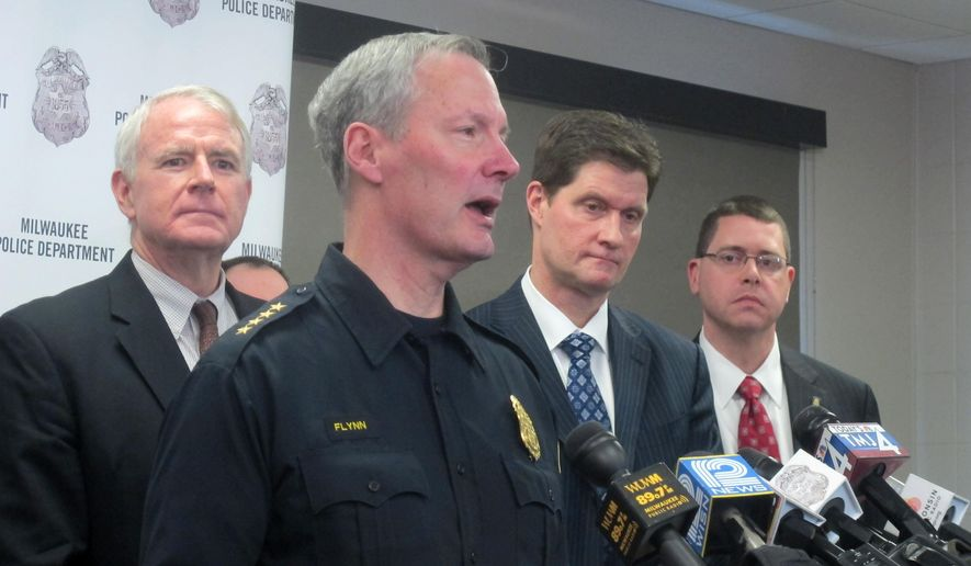 Milwaukee Police Chief Ed Flynn describes how authorities tracked down a rare $5 million Stradivarius violin that was stolen in a brazen Jan. 27 attack, during a news conference as Milwaukee Mayor Tom Barrett, left, Milwaukee County District Attorney John Chisholm and FBI Acting Special Agent in Charge G.B. Jones, far right, Thursday, Feb. 6, 2014 at the Milwaukee Police Department in Milwaukee. Flynn said authorities developed information through tips and interrogations.(AP Photo/Dinesh Ramde)