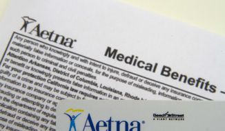 FILE - This Jan. 30, 2012 file photo, shows an Aetna benefits card in Surfside, Fla. Aetna reports quarterly earnings on Thursday, Feb. 6, 2014. (AP Photo/Wilfredo Lee, File)