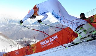 United States' Bode Miller starts in a men's downhill training run for the 2014 Winter Olympics, Thursday, Feb. 6, 2014, in Krasnaya Polyana, Russia. (AP Photo/Alessandro Trovati)