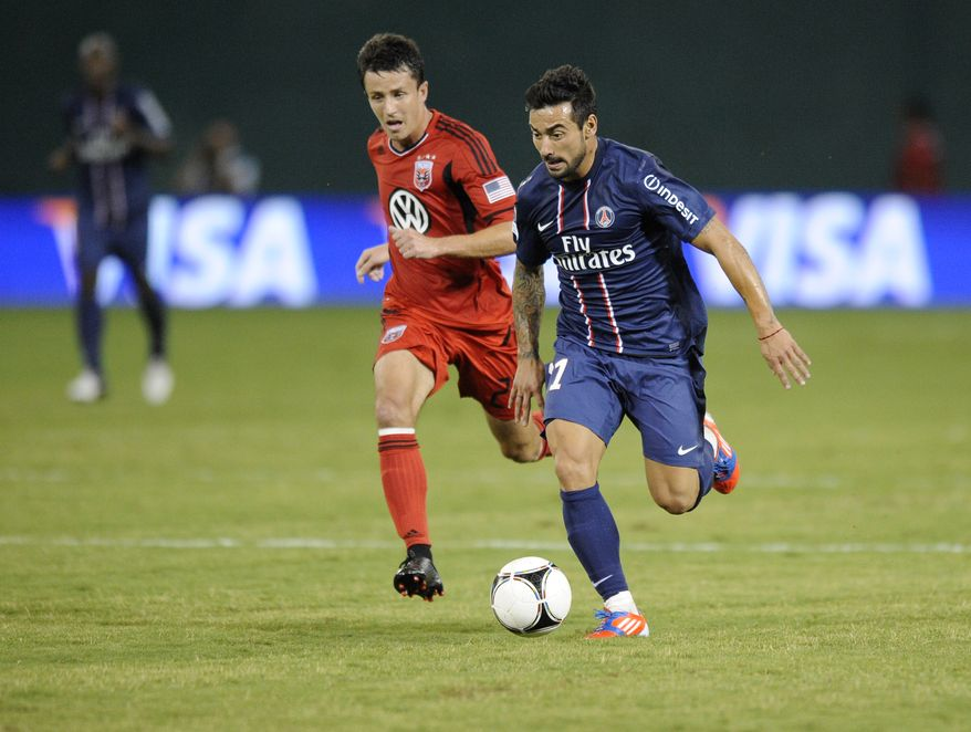 Paris Saint-Germain forward Ezequiel Lavezzi (11) chases the ball against D.C. United midfielder Lewis Neal, left, during the second half of an international friendly soccer game in the World Football Challenge, Saturday, July 28, 2012, in Washington. The game ended in a 1-1 tie. (AP Photo/Nick Wass)