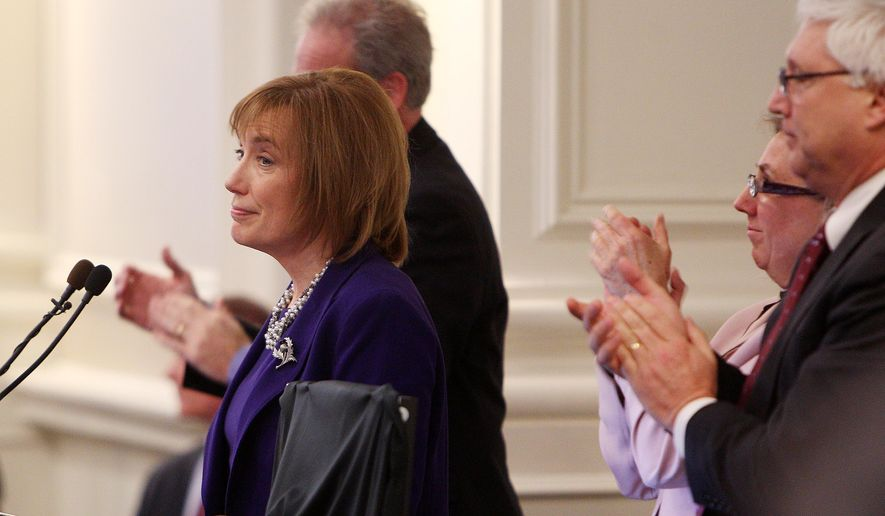 New Hampshire Gov. Maggie Hassan, left, is applauded during her State of the State address at the Statehouse, Thursday, Feb. 6, 2014 in Concord, N.H. (AP Photo/Jim Cole)