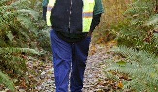 In an undated photo Chukundi Salisbury, Seattle Parks and Recreation's Trails Coordinator, walks along a trail in Fauntleroy Park, one of his ten favorite trails in Seattle parks. Salisbury considers the park one of the best-kept secrets in the Park System. (AP Photo/The Seattle Times, Mike Siegel)  SEATTLE OUT; USA TODAY OUT; MAGAZINES OUT; TELEVISION OUT; NO SALES; MANDATORY CREDIT TO: THE SEATTLE TIMES