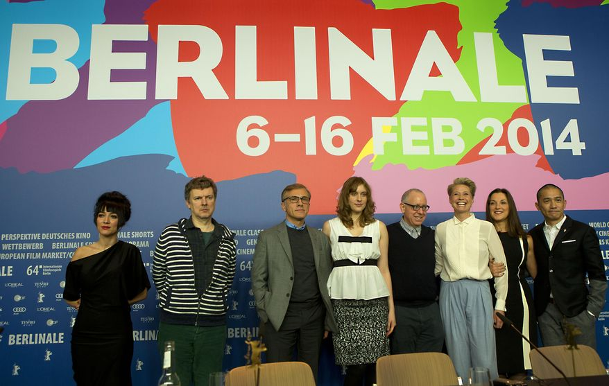 Jury members Mitra Farahani, Michel Gondry, Christoph Waltz, Greta Gerwig, jury president James Schamus, Trine Dyrholm, Barbara Broccoli and Tony Leung pose for photographers at the end of the press conference at the International Film Festival Berlinale, in Berlin, Thursday, Feb. 6, 2014.  (AP Photo/Axel Schmidt)