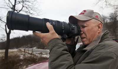 ADVANCE FOR USE SUNDAY, FEB. 9 AND THEREAFTER - In this Jan. 22, 2014 photo, Jeff Ruzicka, of  Martinsburg, Ill., stops to photograph a couple of wild turkeys near Martinsburg before they disappear into the woods. Photography has become a hobby, and a way to fill time, in the past year for Ruzicka. (AP Photo/The Quincy Herald-Whig, Michael Kipley)