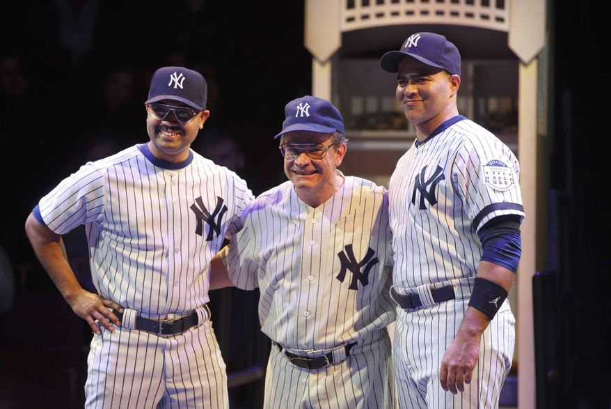 "This image released by Polk & Co. shows Peter Scolari, portraying baseball legend Yogi Berra, center, and Francois Battiste, left, and Christopher Jackson in a scene from the play, ""Bronx Bombers,"" which examines the rich history of the New York Yankees. (AP Photo/Polk & Co., Joan Marcus)"
