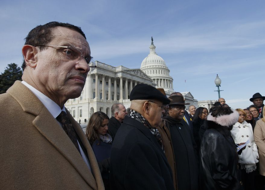 ** FILE ** Washington, D.C. Mayor Vincent Gray joins the Congressional Black Caucus on the national day of prayer to remember the poor and homeless, Thursday, Feb. 6, 2014, on Capitol Hill in Washington.  (AP Photo/J. Scott Applewhite)