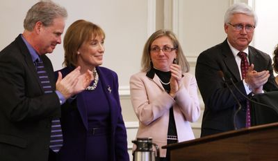 Gov. Maggie Hassan, D-N.H., second from left, is applauded by her husband Tom, far left, and Speaker of the House, Democrat Terie Norelli, center,  and Republican Senate President Chuck Morse,  after delivering her State of the State Address at the Statehouse Thursday, Feb. 6, 2014 in Concord, N.H.(AP Photo/Jim Cole)