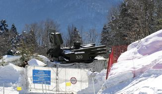 An anti-aircraft missile base sits outside the cross-country skiing venue prior to the 2014 Winter Olympics, Thursday, Feb. 6, 2014, in Krasnaya Polyana, Russia. (AP Photo)