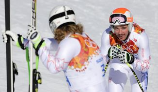 United States' Erik Fisher,left, and United States' Jared Goldberg catch their breath at the finish area during men's downhill training at the Sochi 2014 Winter Olympics, Thursday, Feb. 6, 2014, in Krasnaya Polyana, Russia.(AP Photo/Gero Breloer)